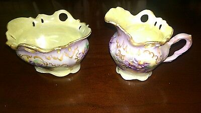 1906 ANTIQUE PORCELAIN FOOTED FLORAL CREAMER AND SUGAR BOWL HAND PAINTED LUSTER