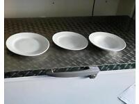 Various sizes white plates and dishes