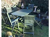 Hardwood garden table and six chairs freshly painted in Cuprinol Somerset green