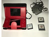 Red Nintendo DS with charger and 3 games