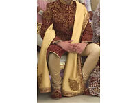 Mens sherwani wedding outfit. Stunning maroon and gold asian wedding groom