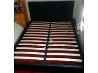 Black leather bed frame with mattress