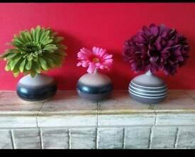 Small vases with the flowers