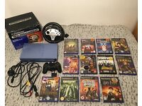 Playstation 2 Console Comes With 13 Games + PS2 Tournament Steering Wheel