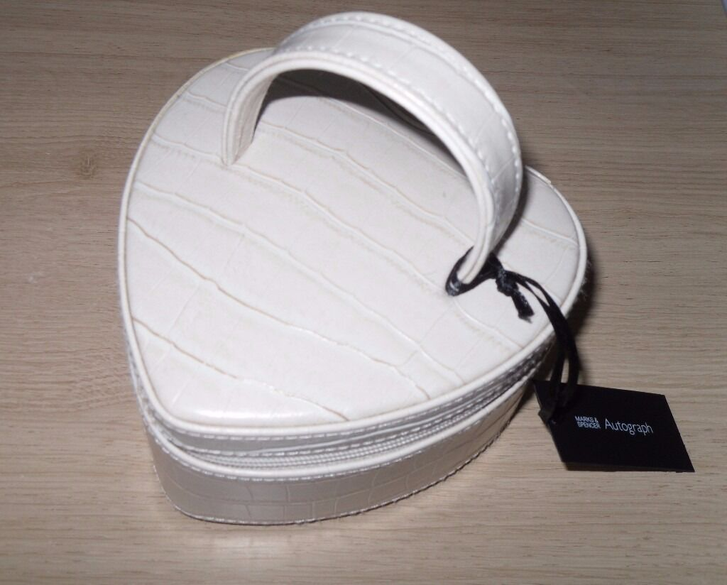 Jewellery BoxPretty M&S Autograph Heart shapedPerfect Gift15in Woodley, BerkshireGumtree - Jewellery Box Pretty M&S Autograph Heart shaped Perfect Gift £15 New & Unused Cream coloured mock croc outer & faux suede lining with zip & handle. Approx 12 x 12 x 7 cms [depth exc. handle] or 5 x 5 x 2.75 inches. Bargain at £15 buyer collects