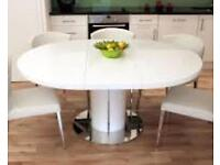 White high gloss large extending round/oval dining table with 6 white leather & walnut chairs chrome