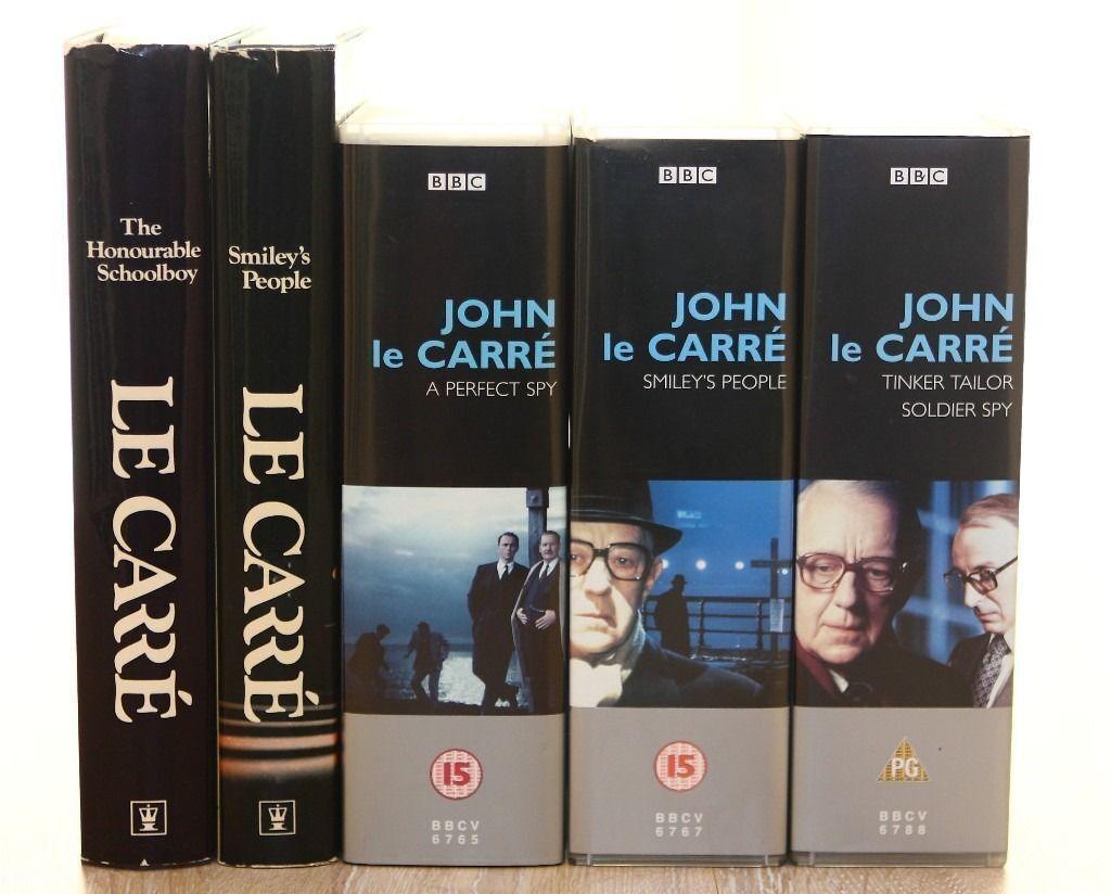 JOHN LE CARRE - TWO HARDBACK BOOKS & THREE VHS BOX SETS
