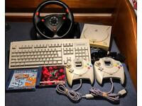 SEGA DREAMCAST CONSOLE + 2 CONTROLLERS + STEERING WHEEL + KEYBOARD + TWO GAMES!