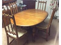 Extendable dinning room table and 4 chairs