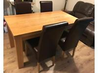 Solid Oak Dining Table and 4 Roll Back Leather ChairsGreat Condition Delivery Available