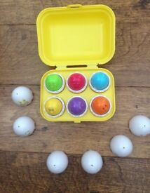 Tomy hide and squeak activity egg toy