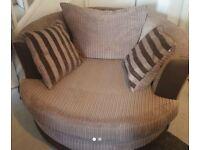 DFS swivel cuddle chair brown 100 ono