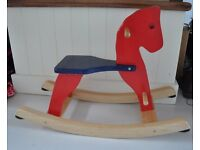 Colourful wooden rocking horse ride-on