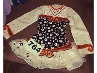 Irish dancing dress age 9-11. Orange, white and black