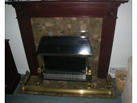Dark wood fire surround plus marble hearth and backplate