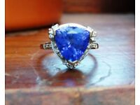 Tanzanite Ring. AAA 3.2 cts with small diamonds in 18ct white gold