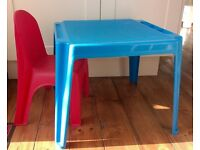 Plastic table and one chair. Perfect for garden in the summer