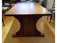 Large heavy beautiful wood dining table with unusual base