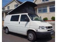 VW transporter T4 Camper 2003 PopTOP bed, and utilities.