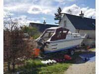 20 foot fishing / cruiser boat with 65hp Suzuki. Lots of extras, hummingbird 150 fishfinder
