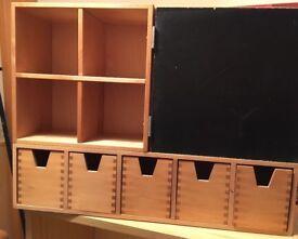 Ikea blackboard with drawers.