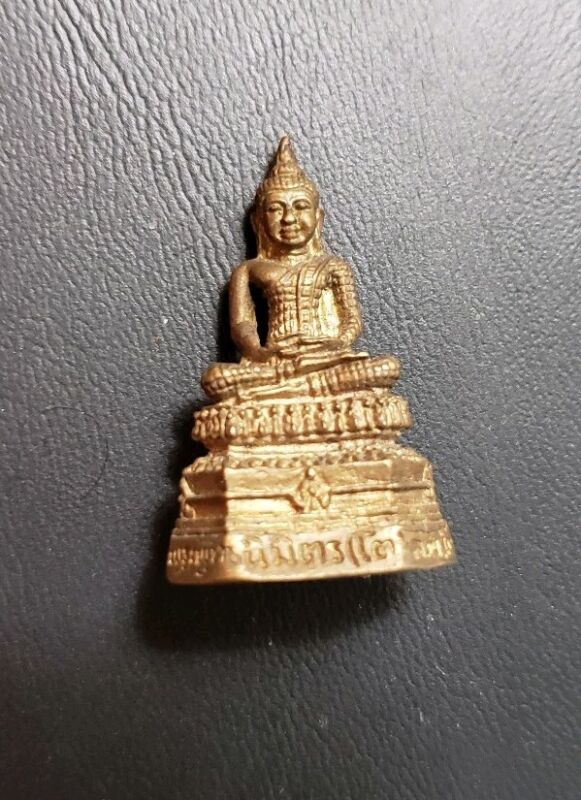 1/2 INCH MINIATURE BUDDHA PHRA KRING WITH EMBEDDED BALL INSIDE.