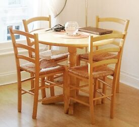 Round countryside style wooden dining table (no chairs)