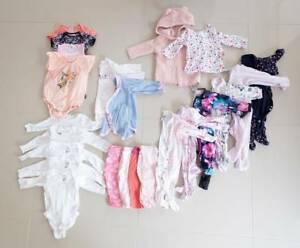 Baby clothing / size 00 (6mths) / 23 items / very good cond.