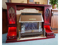 MAHOGANY FIREPLACE WITH MARBLE HEARTH AND SURROUND WITH DISPLAY CABINETS WITH LIGHTING.