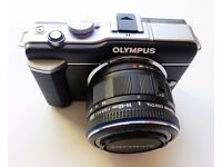 Olympus Pen E-PL1 Micro 4/3 compact system camera with original 14-42mm zoom lens