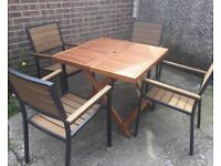 Hardwood Dining Table & 4 PollyWood Chairs, Never Used.