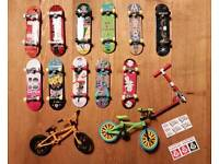 Selection of Tech deck and other fingerboards, bikes and scooter.