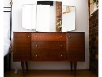 Stunning Mid Century Uniflex Drawers with Mirror by Peter Hayward designed for Heals