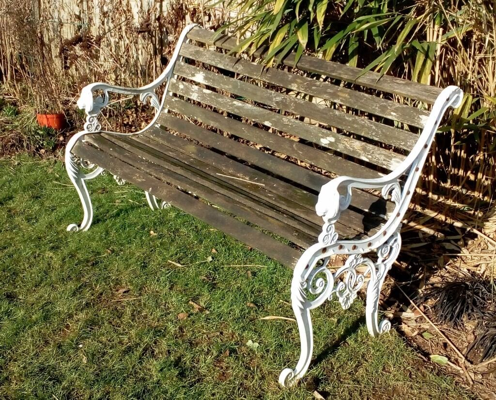 bench with arms. VINTAGE WOODEN GARDEN BENCH - CAST METAL SIDES WITH LION HEAD DETAIL TO ARMS Bench With Arms O