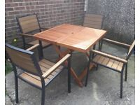 Hardwood Dining Table And Four Pollywood Chairs.