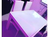White glass extending dining table