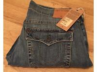 Brand new with tags, authentic men's True Religion jeans. Waist 34. Ricky style. Thin stitch
