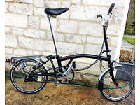 Brompton M3R Folding Bike. Original 3 speed model in classic black with rack, dynamo and mudguards.
