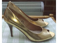 Women's gold high-heeled shoes. Size 8. Made by Fiore. Worn only once on carpet.