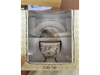 Christening gifts - egg cups and silver forks/knives and dummy
