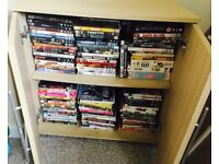 200+ DVD's and box sets PLUS Cabinet
