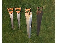 Four vintage carpenter's hand saws