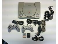Sony Playstation 1 PS1 with 2 controllers, leads and 20 games