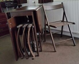 oval dining room table with four chairs chocolate in colour solid wood