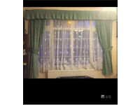 2 pairs of green curtains