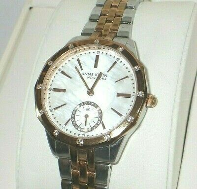 Anne Klein Women's 12/2305MPRT Crystal Accented Two Tone Watch w/ MOP Dial