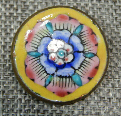 1 cupid button in painted enamels 1 and a half inch by 2 inch.