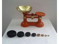 Vintage weighing scales with weights.