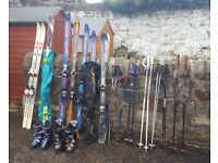 6 sets of skis with ski poles