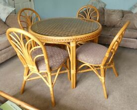 Kitchen Table with Glass Top and Matching four Chairs excellent quality